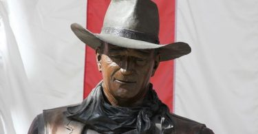 OC Democrats Demand John Wayne's Name + Statue Removed from Orange County Airport